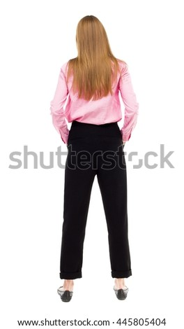 back view of standing young beautiful  woman. Rear people collection.  backside of person.  Isolated over white background. A girl in pink shirt stands with his hands in his pockets