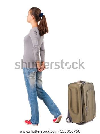 back view of standing young traveling brunette woman with suitcas. girl  watching. Rear view people collection.  backside view of person.  Isolated over white background.