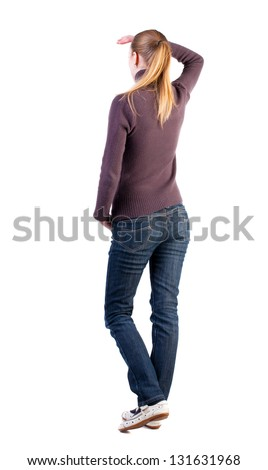 back view of standing young woman. girl hand covers his eyes from bright light. girl in jeans  watching. Rear view people collection. backside view of person.  Isolated over white background - stock photo