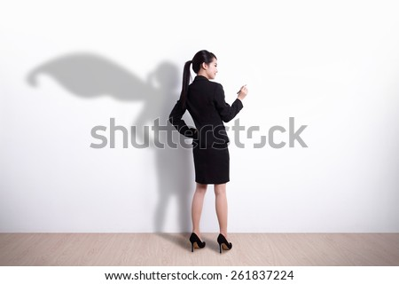 Back view of Superhero business woman writing something on white wall background, great for your design or text, asian - stock photo