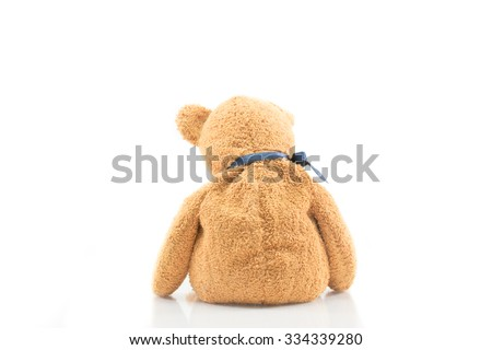 Back view of teddy bear on white isolated background, use for sadness or love concepts. - stock photo