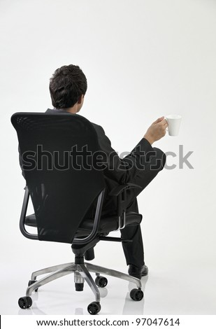 back view of the businessman sitting on the chair - stock photo