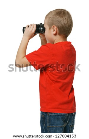 Back view of the six years boy looking away through the binoculars over white background