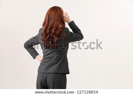 back view of the woman hand on the head - stock photo