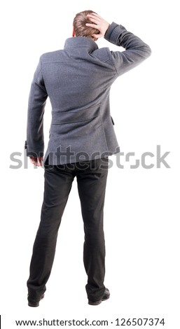 Back view of thinking business man in coat. gesticulating adult businessman  .  backside view of person.  Isolated over white background. Rear view people collection. - stock photo