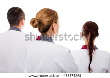back view of three nurses  isolated on white