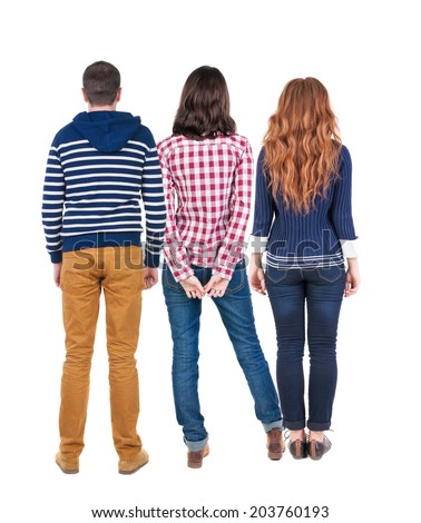 Back view of three people. beautiful friendly girl and guy together. Rear view. Isolated over white background. young woman holds the hand of her husband looking away