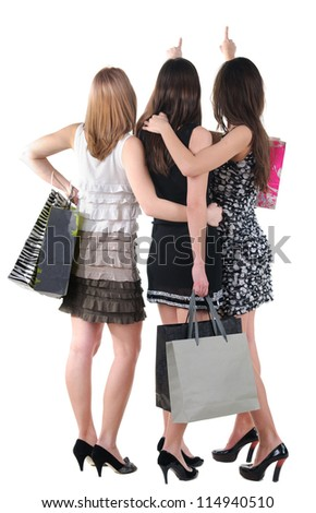 Back view of three woman with shopping bag.Rear view people collection.  backside view of person.  Isolated over white background.