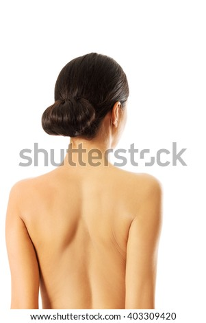 Back view of topless woman - stock photo