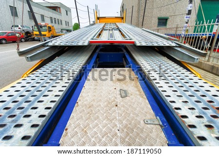 back view of tow carrier truck - stock photo