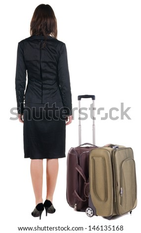Back view of traveling business woman  with  suitcase looking up.   Standing young girl . Rear view people collection.  backside view of person.  Isolated over white background. - stock photo