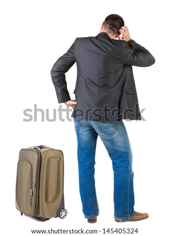 Back view of traveling busness man with  suitcase looking up. Standing young guy in jeans and  jacket. Rear view people collection.  backside view of person.  Isolated over white background.