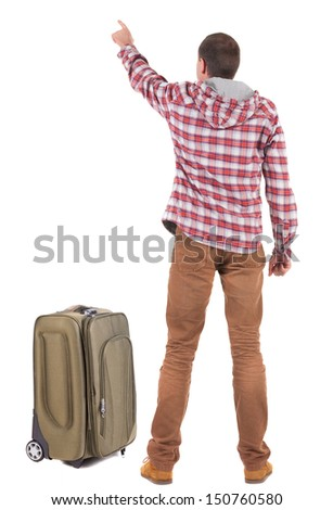 Back view of traveling man with suitcase pointing. Rear view people collection.  backside view of person.  Isolated over white background.  - stock photo