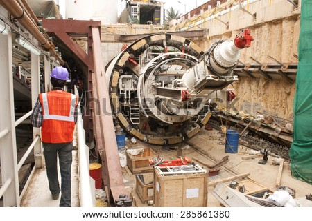Back view of tunnel boring machine in an access shaft being assembled in Bangalore, India