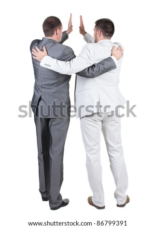 back view of two joyful businessmen with success gesture . Rear view. Isolated over white background.
