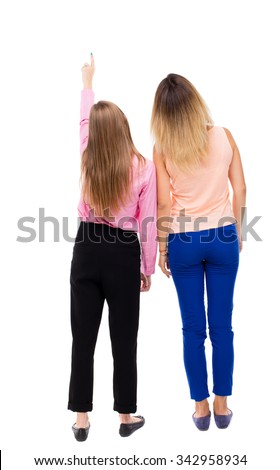Back view of two pointing young girl. Rear view people collection.  backside view of person.Rear view. Isolated over white background. two girls looked up staring at something in the sky. - stock photo