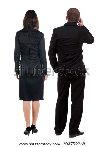 Back view of two young business people hug and look into the distance. Rear view. Isolated over white background. young woman holds the hand of her husband looking away