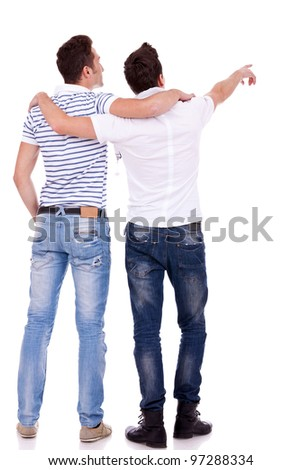 Back view of  two young men pointing at something. Rear view. Isolated over white background. - stock photo