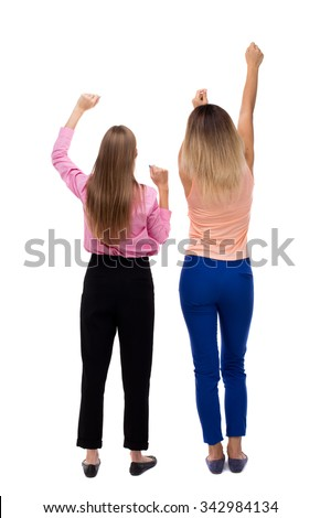 Back view of two young  women dancing.  Rear view people collection.  backside view of person.  Isolated over white background. Two girls blonde waving their arms. - stock photo
