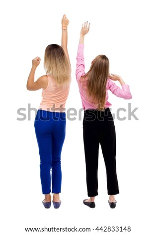 Back view of two young  women dancing.  Rear view people collection.  backside view of person.  Isolated over white background. Two blonde girls dancing waving his arms. - stock photo