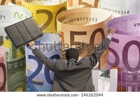 Back view of victorious businessman with briefcase against rolled up Euros - stock photo