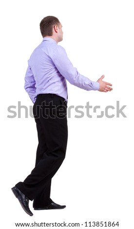 back view of walking business man in trousers and shirt,hand shake . Rear view people collection. backside view of person. Isolated over white background.