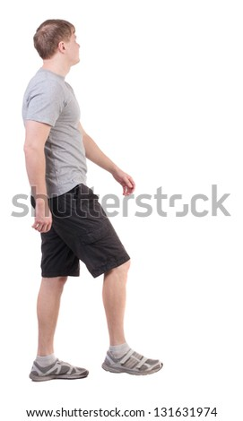 Back view of walking handsome man in shorts and sneakers.   Sports-dressed young man moves. going young guy. Rear view people collection.  backside view of person.  Isolated over white background. - stock photo