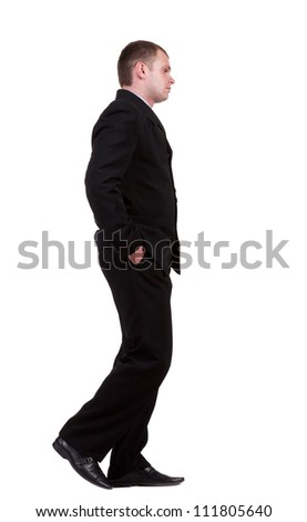 back view of walking sad business man. going young guy in black suit. Isolated over white background. Rear view people collection.  backside view of person. - stock photo