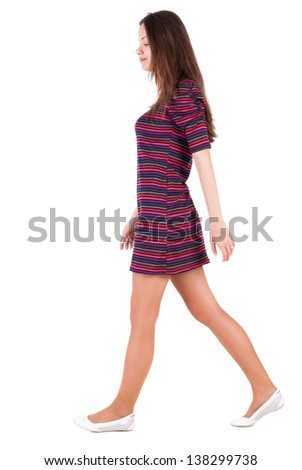 back view of walking  woman . beautiful brunette girl in motion.  backside view of person.  Rear view people collection. Isolated over white background. A smiling girl goes past us - stock photo