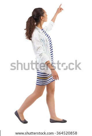 back view of walking  woman. beautiful girl pointing.  backside view of person.  Rear view people collection. Isolated over white background. Swarthy woman is pointing upwards. - stock photo