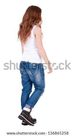 back view of walking  woman . beautiful redhead girl in motion.  backside view of person.  Rear view people collection. Isolated over white background. Teenager girl with long curly red hair goes away - stock photo