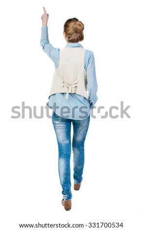 back view of walking  woman. beautiful redhead girl pointing.  backside view of person.  Rear view people collection. Isolated over white background. office worker woman going.  - stock photo