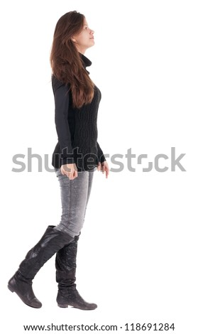 back view of walking  woman  in  black sweater. beautiful brunette girl in motion.  backside view of person.  Rear view people collection. Isolated over white background.