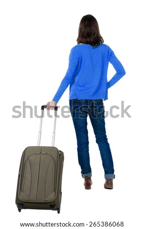 back view of walking  woman  in cardigan with suitcase. beautiful  girl in motion.  backside view of person.  Rear view people collection. Isolated over white background. - stock photo