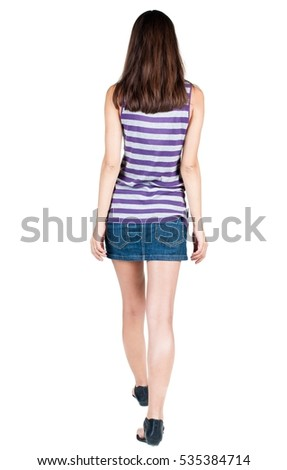 back view of walking  woman in dress. beautiful brunette girl in motion.  backside view of person.  Rear view people collection. Isolated over white background.