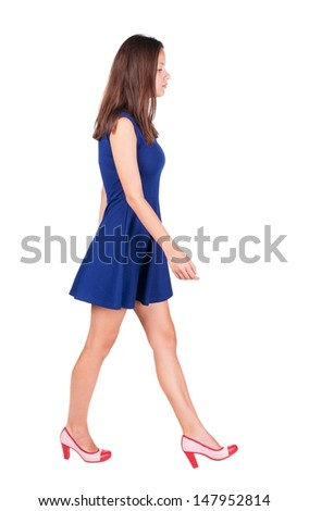 back view of walking woman in dress . going gir in motion. Rear view people collection.  backside view of person. Isolated over white background. - stock photo