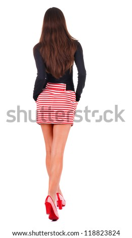back view of walking  woman  in red dress. beautiful brunette girl in motion.  backside view of person.  Rear view people collection. Isolated over white background. - stock photo