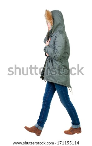 back view of walking  woman in warm jacket. beautiful brunette girl in motion.  backside view of person.  Rear view people collection. Isolated over white background. - stock photo