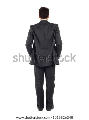 Back view of whole body of a business man in black suit isolated on white background.