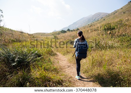 Back view of woman go hiking - stock photo
