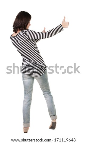 Back view of  woman thumbs up. Rear view people collection. backside view of person. Isolated over white background. slender brunette in a jeans shows the symbol of success or hitchhiking - stock photo