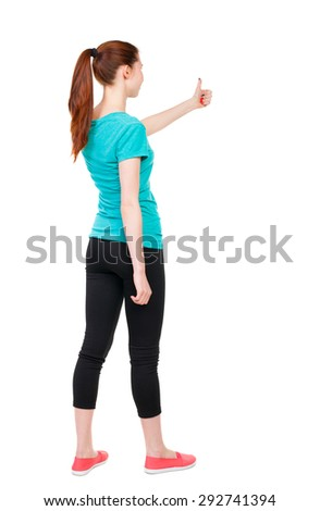 Back view of  woman thumbs up. Rear view people collection. backside view of person. Isolated over white background. Sports girl is holding up his left hand with a thumbs up gesture. - stock photo