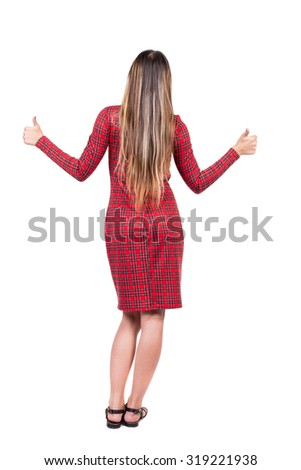 Back view of  woman thumbs up. Rear view people collection. backside view of person. Isolated over white background. The girl in red plaid dress shows thumbs up. - stock photo