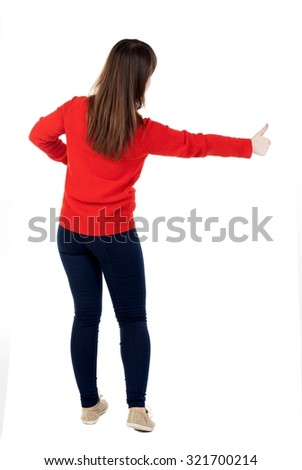 Back view of  woman thumbs up. Rear view people collection. backside view of person. Isolated over white background. The girl in the red sweater taxi.