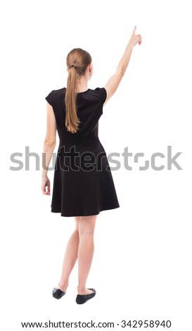 Back view of  woman thumbs up. Rear view people collection. backside view of person. Isolated over white background. The blonde in a black dress shows a finger up his right hand. - stock photo