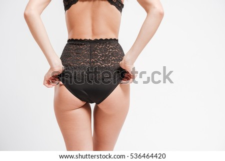 Back view of women's body in sexy lingerie isolated on a white background