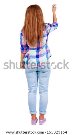 back view of writing beautiful redhead woman. Young girl in jeans draws. Rear view people collection.  backside view of person. Isolated over white background. - stock photo
