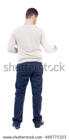 back view of writing business man. Rear view people collection.  backside view of person. Isolated over white background. The bearded man in a white warm sweater draws a felt-tip pen at the bottom of