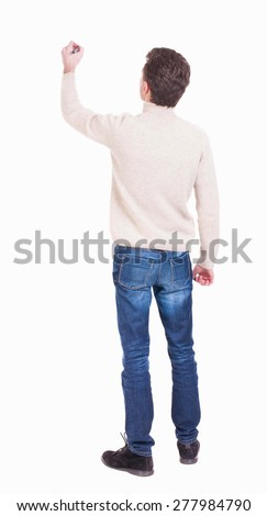 back view of writing man in a white knit sweater. Young man in jeans draws. Rear view people collection.  backside view of person. Isolated over white background. - stock photo