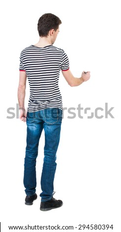 back view of writing man. Young man in jeans draws. Rear view people collection.  backside view of person. Isolated over white background. The guy in the striped shirt felt-tip pen draws ahead. - stock photo